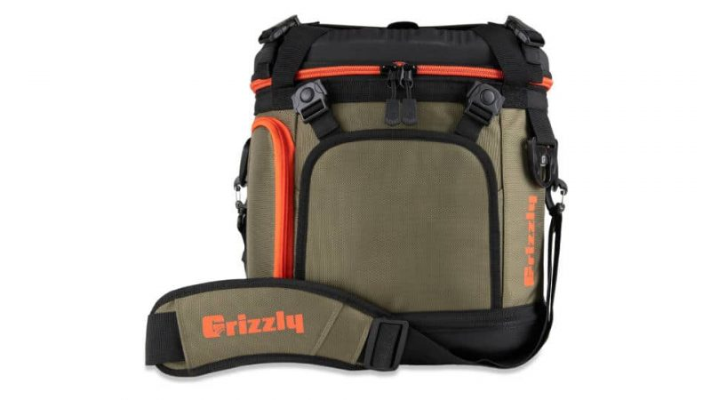 front view with shoulder strap of grizzly drifter 20 soft sided cooler in green/black/orange
