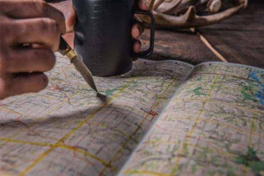 insulated coffee cup sitting on a map