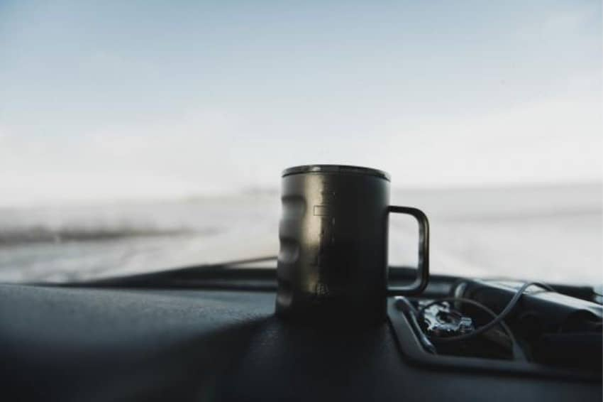 camp cup on dashboard of vehicle