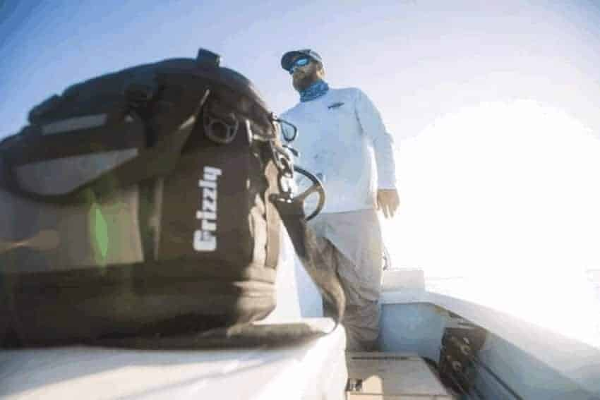 drifter 20 soft sided cooler on boat with man and sun in background