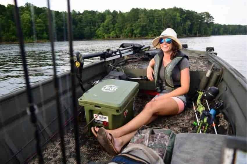 grizzly 20 cooler in fishing boat with woman sitting next to it