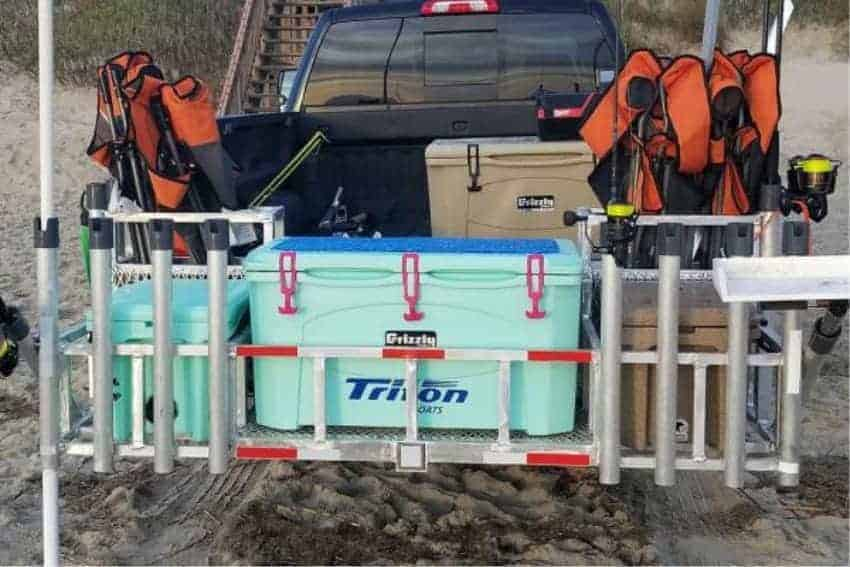 grizzly 75 rotomolded cooler in back of pickup on beach with other hard sided coolers