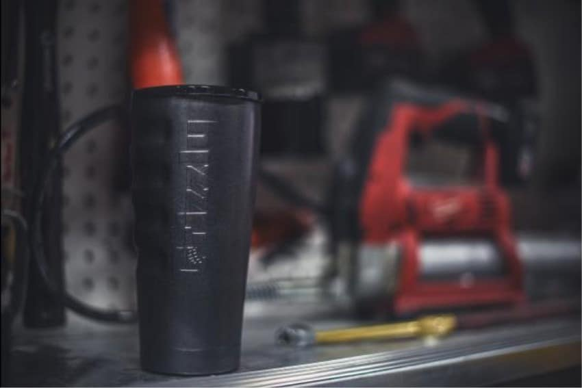 20 oz textured charcoal grizzly grip cup sitting on workbench