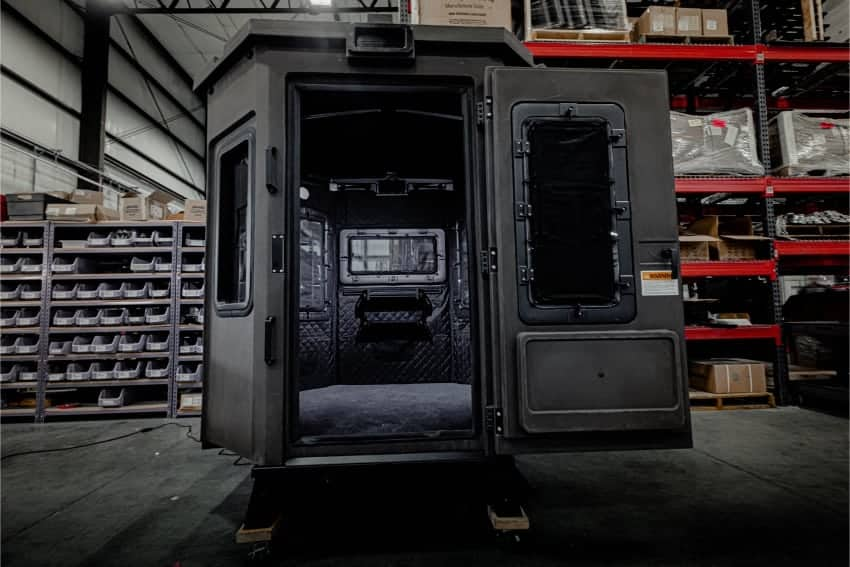 grizzly box blind setup in warehouse with door open showing box blind insulation setup on walls