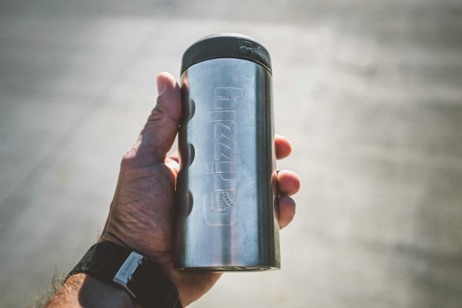 grizzly coolers drinkware, slim can koozie in palm of a hand
