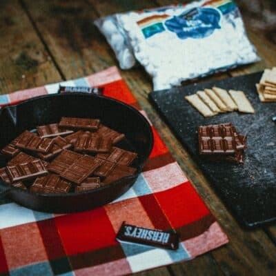 cast iron camping recipes melting hershey chocolate bars in skillet
