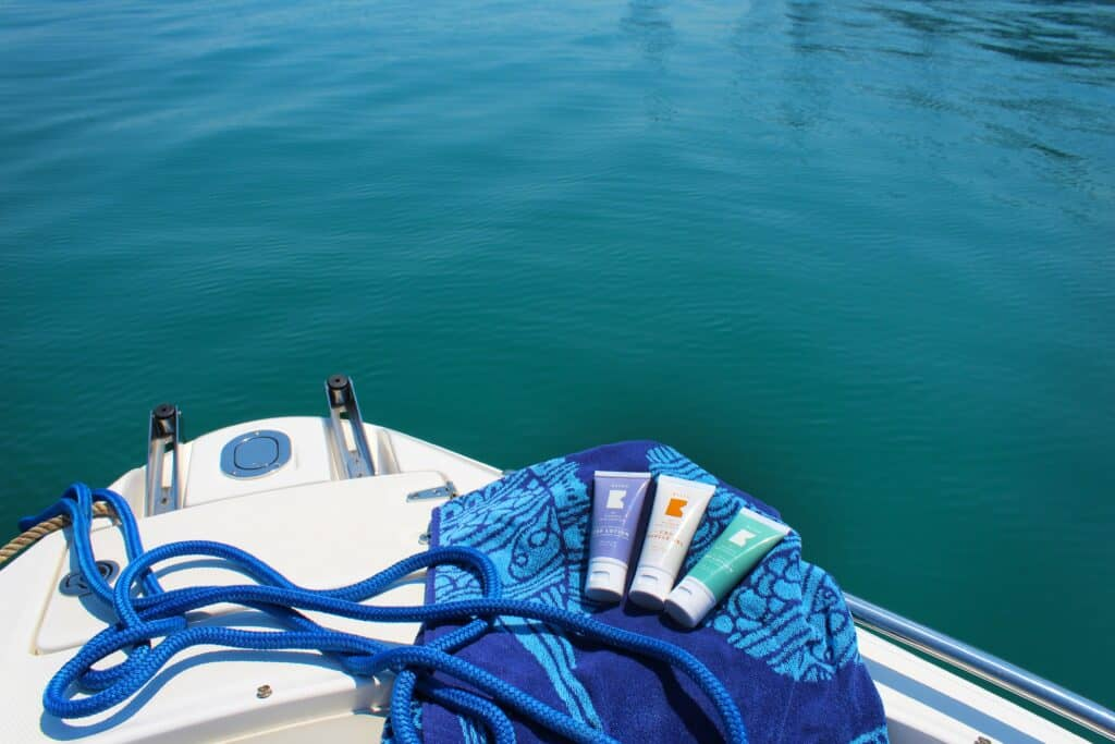 Sunscreen Sitting On Bow Of Boat On Water