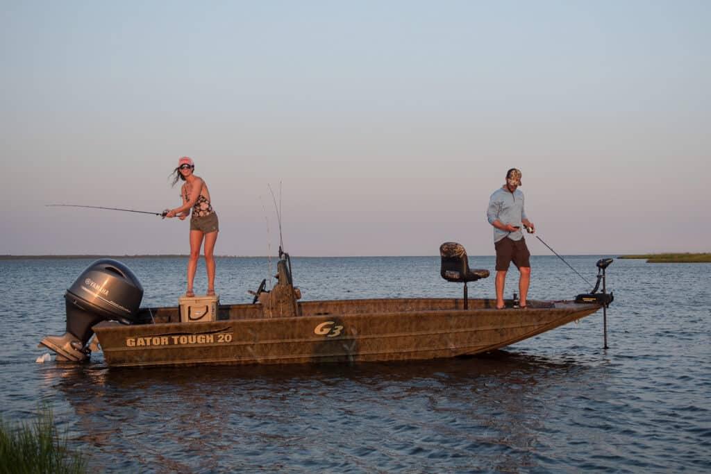 Bass Season, 2 Anglers Standing On Boat Fishing For Bass