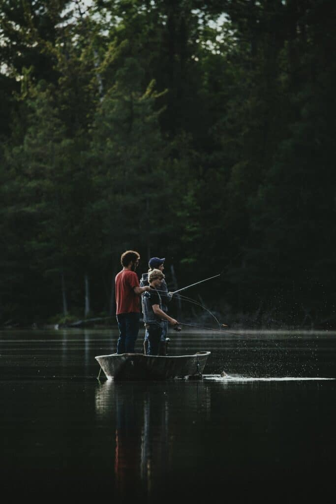 2 Young Anglers Fishing From A Boat During Bass Season