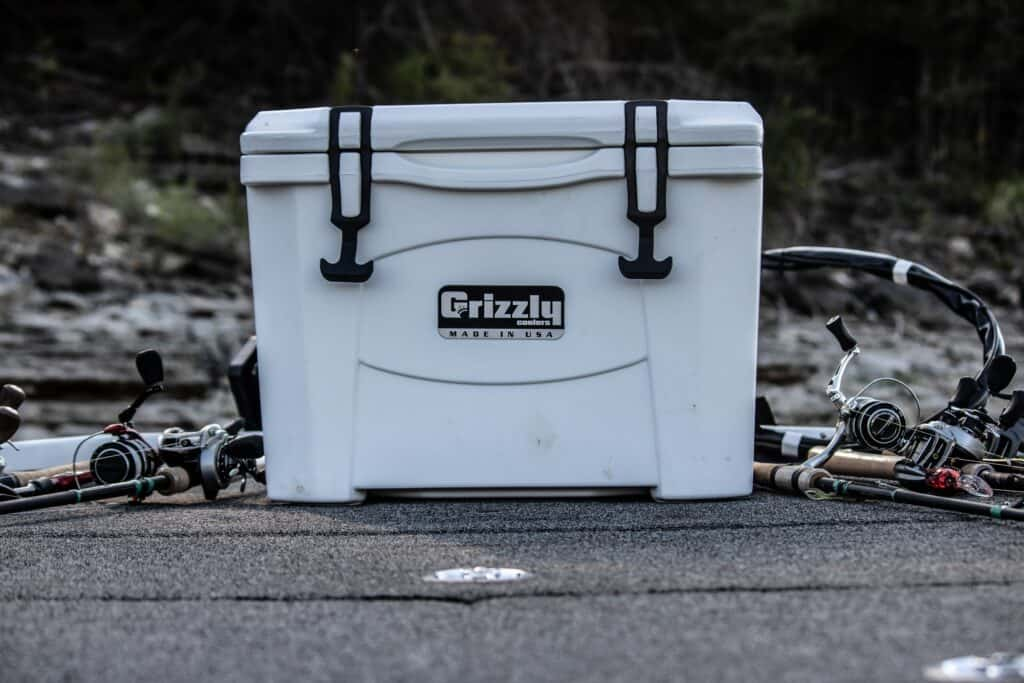 Grizzly Cooler With Fishing Gear On Boat