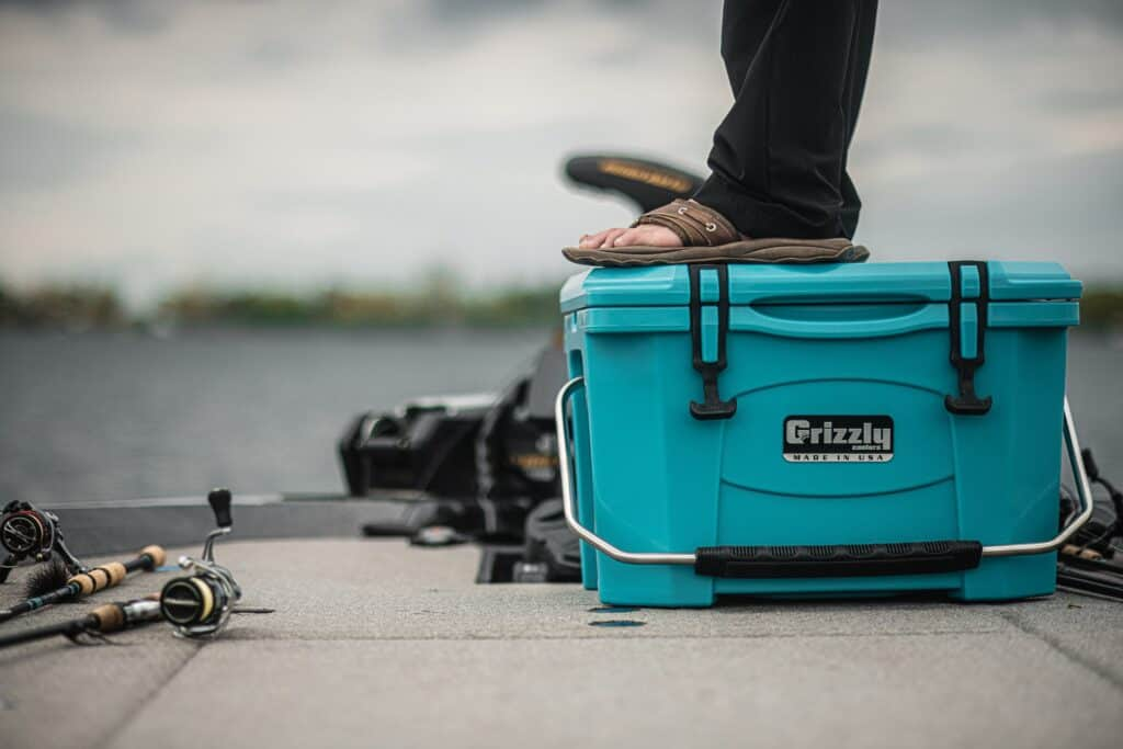 Mille Lacs Lake Fishing With Matt Peters Standing On A Teal Grizzly 20 Cooler On Boat