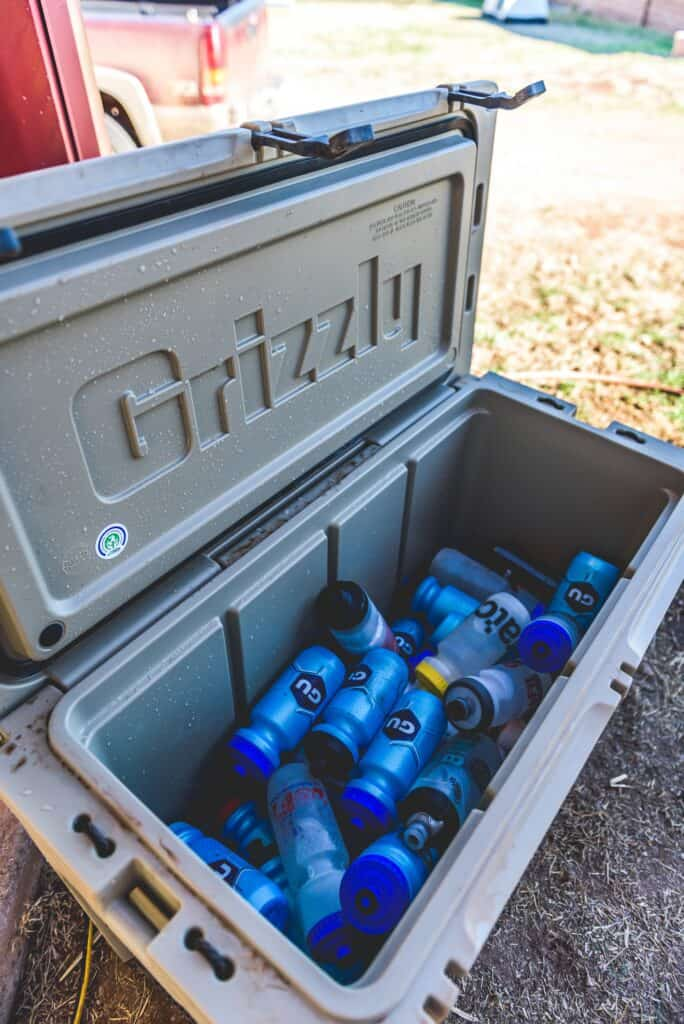 Grizzly Cooler Working On The Job Site, Opened And Filled With Cold Water Bottles