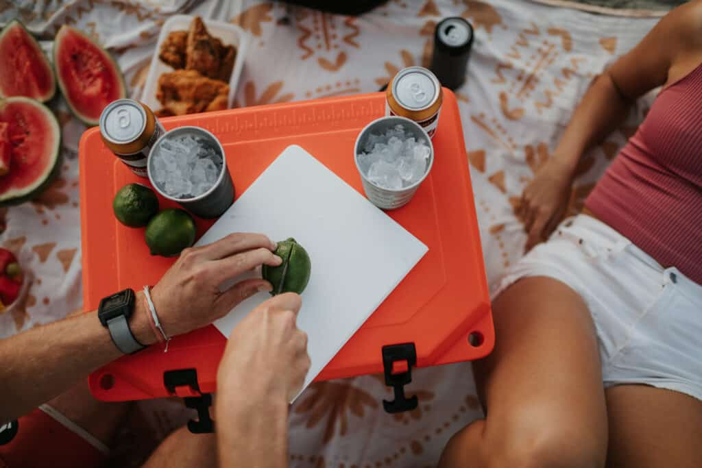 Using The Top Of A Grizzly Cooler As A Table For A Picnic