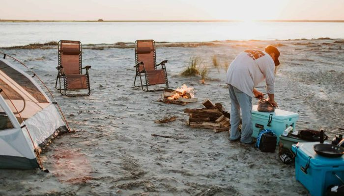 beach campsite with water in background